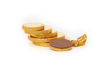 Close-up Of Chocolate Coins Over White Background