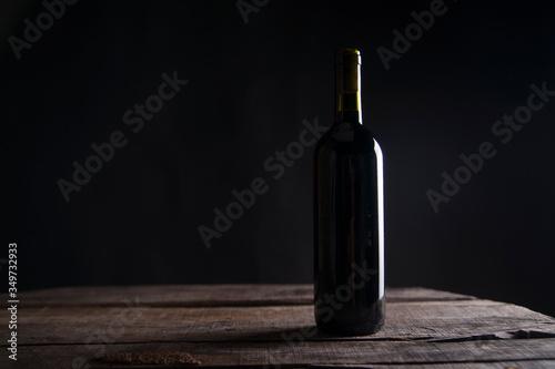 Cuadros en Lienzo Bottle On Table In Darkroom