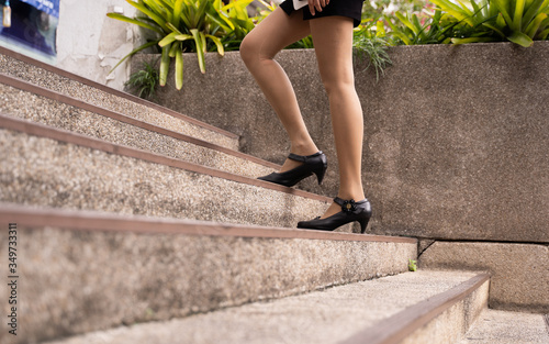 Canvas-taulu Low Section Of Woman Walking On Steps