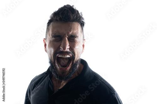 Screaming male person silhouette, back lit light Fototapet