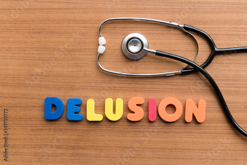 Vászonkép Directly Above Shot Of Alphabets Making Delusion Text By Stethoscope On Table