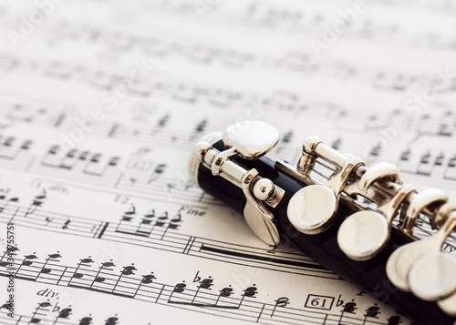 Close-up Of Woodwind Instrument On Sheet Music