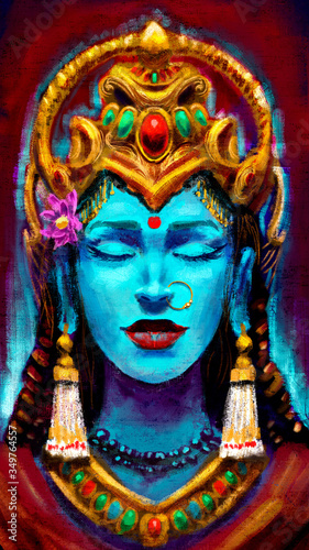Fotografia An Indian goddess in the form of a beautiful woman with turquoise skin, adorned with many gold ornaments, her eyes closed in peace
