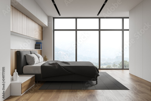 Obraz White and wooden master bedroom with window - fototapety do salonu