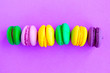 canvas print picture - Sweet color macaroons on bright purple background. Flat lay, top view