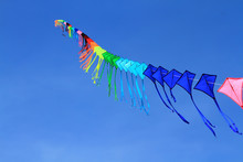Low Angle View Of Kites Flying...