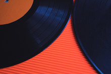 Two Black Vinyls Arranged On A Red Background, Top View