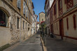 Street of Bayonne in France with buildings in the Nive River
