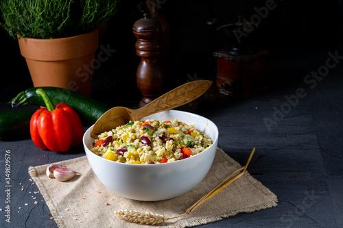 Fototapeta bulgur kaszotto with fresh vegetables and kidney bean obraz