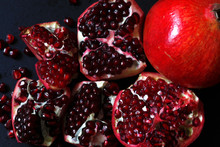 Close-up Of Pomegranates On Bl...