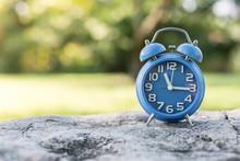 Close-up Of Alarm Clock On Rock