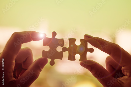 Fototapety, obrazy: Cropped Hand Holding Jigsaw Pieces