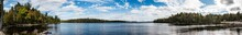 A Panoramic Shot Of A Lake In Algonquin Provincial Park In Ontario, Canada, In The Beatiful Wilderness Of This Park This Lake Is Surrounded By Trees, Rocks And Just Nature.