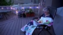 Mature Woman Sitting And Readi...