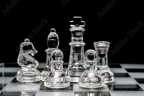 Fotografia Close-up Of Chess Pieces Against Black Background