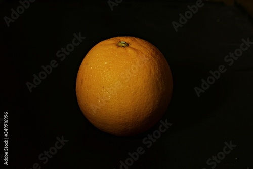 Close-up Of Orange Over Black Background