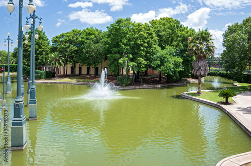 pond and greenery of armstrong park Canvas Print