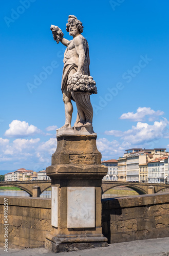 Statue of Autumn or Bacchus on Holy Trinity Bridge of Florence, Italy Canvas Print