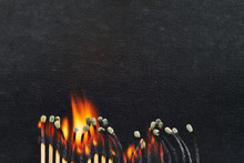 Close-up Of Burning Matchsticks