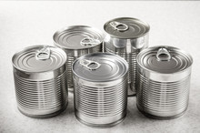 Set Of Various Canned Foods In Tin Cans On Kitchen Table, Non-perishable, Long Shelf Life Food For Survival In Emergency Conditions Concept