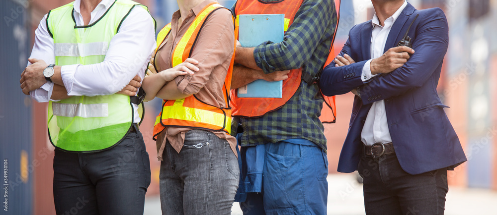 Fototapeta Banner of factory construction site or container warehouse people standing with arms crossed. Logistic business corporate teamwork successful. engineer foreman, assistant and workers working together