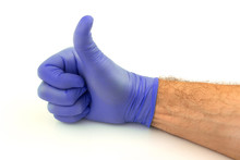 Male Hand With Purple Rubber Glove