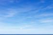 Leinwandbild Motiv Beautiful blue sky with cirrus clouds over the sea. Skyline.