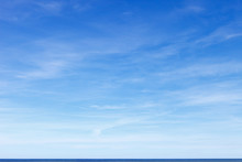 Beautiful Blue Sky With Cirrus Clouds Over The Sea. Skyline.