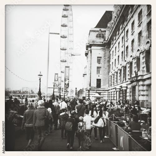 Fototapeta People Walking On Street Against London Eye
