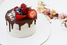 White Cream Cake With Chocolate Streaks And Strawberries. A Birthday Present. Selective Focus.