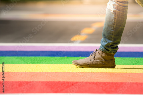 Fotomural Low Section Of Man Walking On Colorful Street
