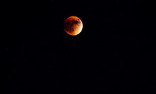 Idyllic Shot Of Blood Moon In Sky During Lunar Eclipse