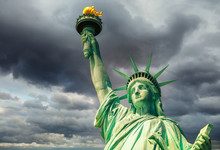 Statue Of Liberty Over Dramatic Stormy Sky, New York
