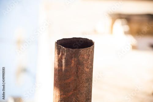 Old crumpled metal rust drainpipe is close Tapéta, Fotótapéta