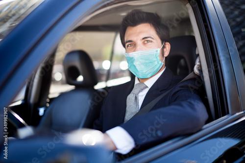 Stampa su Tela Masked man driving his car