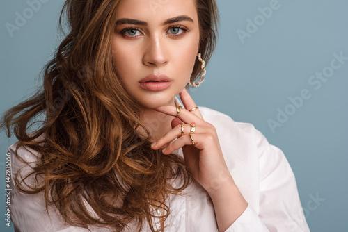 Stampa su Tela Beautiful woman with long waved hair wearing trendy pearl earrings, rings