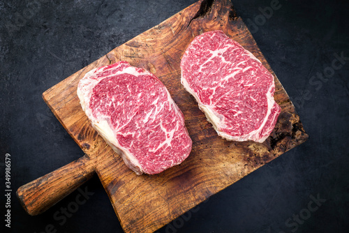 Fototapeta Raw dry aged wagyu entrecote beef steak roast as top view on a rustic wooden cutting board obraz