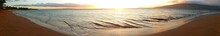 Panoramic View Of Beach And Sea Against Sky During Sunset