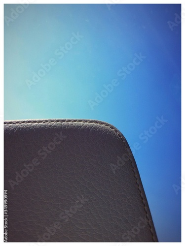 Cropped Image Of Leather Chair Backrest Against Clear Blue Sky Canvas Print