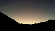Low Angle View Of Silhouette Mountains Against Sky During Sunset