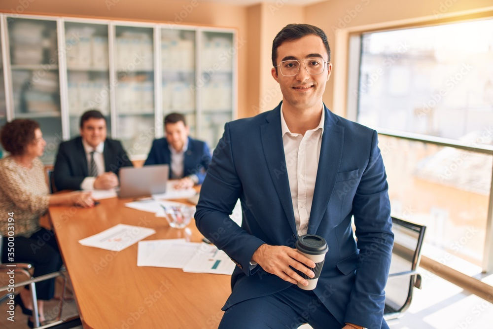 Fototapeta Business lawyers workers meeting at law firm office. Professional executive partners working on finance strategry at the workplace. Leader worker standing confident looking at the camera.