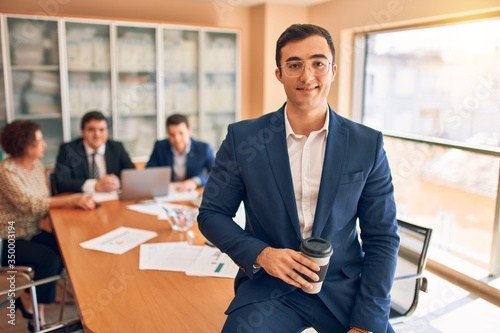 Obraz Business lawyers workers meeting at law firm office. Professional executive partners working on finance strategry at the workplace. Leader worker standing confident looking at the camera. - fototapety do salonu