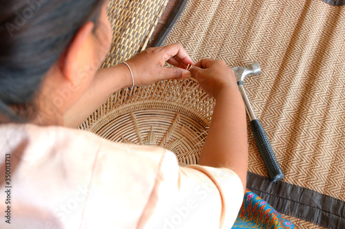 villager took bamboo stripes to weaving basket Canvas-taulu