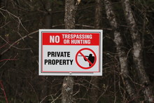 No Trespassing Or Hunting Sign...