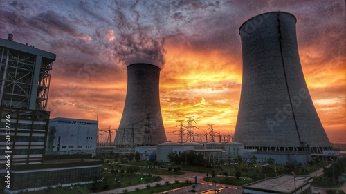 Fotografie, Obraz Power plant at sunset