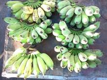 High Angle View Of Unripe Bananas On Table