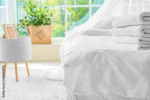 Fototapeta Big comfortable bed with clean linen in room