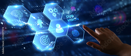 Obraz Business, Technology, Internet and network concept. Young businessman working on a virtual screen of the future and sees the inscription: Our vision - fototapety do salonu