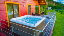 Hot Tub With Water On The Terr...
