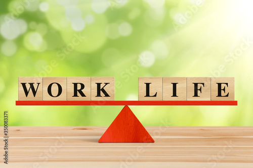 Fototapeta Balance between Life And Work on seesaw.
